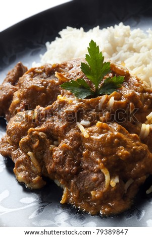 Rogan josh with rice.  Delicious Indian curry. - stock photo