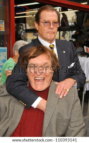 Roger Moore and Richard Kiel  at the ceremony honoring Roger Moore with the 2,350th Star on the Hollywood Walk of Fame. Hollywood Boulevard, Hollywood, CA. 10-11-07 - stock photo