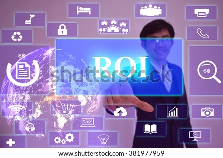 ROI concept  presented by  businessman touching on  virtual  screen ,image element furnished by NASA - stock photo