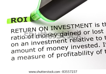 ROI - Return On Investment highlighted with green marker. - stock photo