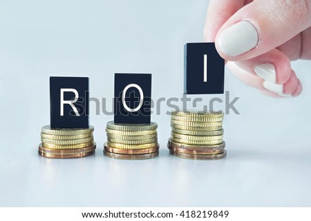 ROI text stacked on coins with cool image temperature