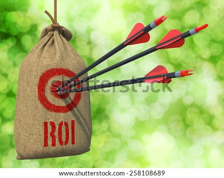 ROI - Three Arrows Hit in Red Target on a Hanging Sack on Natural Bokeh Background. - stock photo
