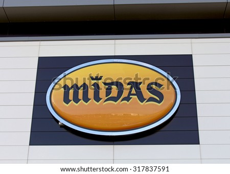 ROISSY EN BRIE, FRANCE - SEPTEMBER 10, 2015: Logo of the Midas brand in Roissy en Brie, France. Midas is a company for service and quick repair of American origin . - stock photo