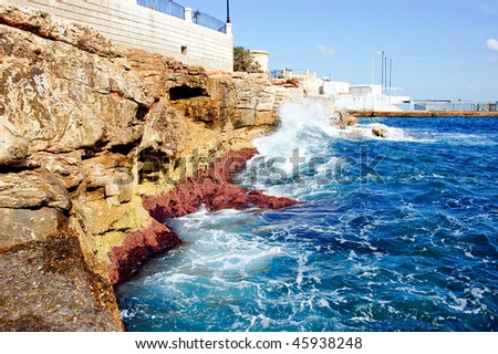 roky seaside with hotels along on a sunny day in malta, low angle - stock photo