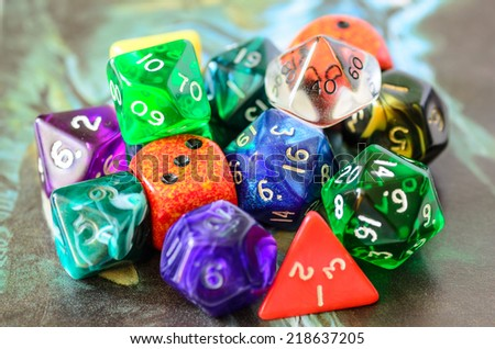 role playing dices lying on picture background - stock photo - stock photo