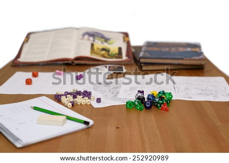 role playing game set up on table isolated on white background - stock photo