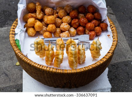 Roll cakes made by minced and cooked mung bean, then be covered with sugar liquid. They are one of street style food in Vietnam. - stock photo