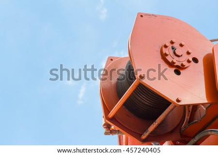 roll crane sling against blue sky free copy space for text   - stock photo