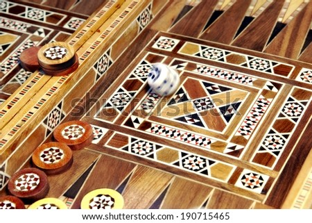 Roll Dice and Backgammon Game Board. Background with space for text or image. - stock photo