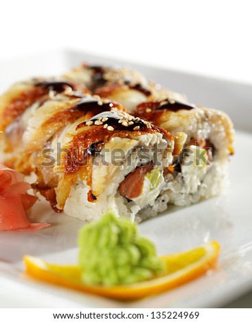 Roll made of Fresh Raw Salmon, Smoked Eel, Cream Cheese and Avocado inside. Topped with Smoked Eel (unagi)