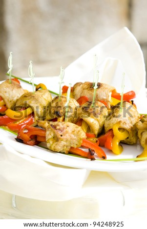 Roll meat with yellow and red peppers, sauce, vegetables - stock photo