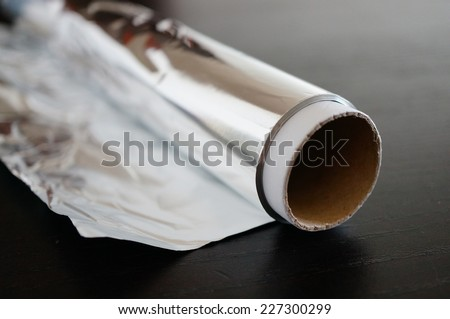 Roll of aluminum foil - stock photo