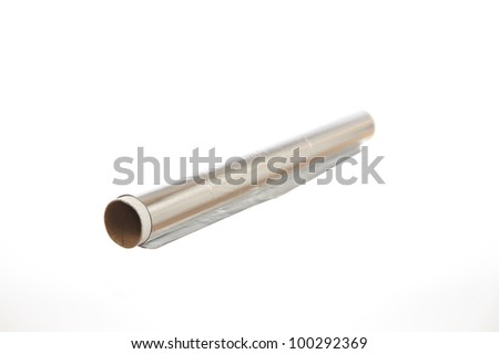Roll of aluminum foil isolated on white background - stock photo