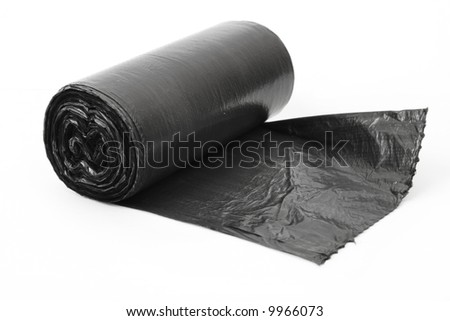 roll of black dustbin liners isolated on white background - stock photo