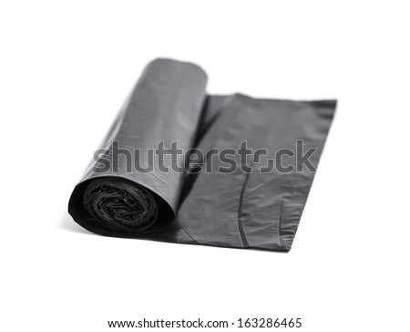 Roll of black trash bags isolated on white background - stock photo