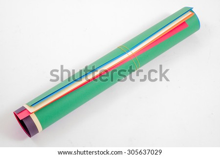Roll of colored corrugated papers on white background - stock photo