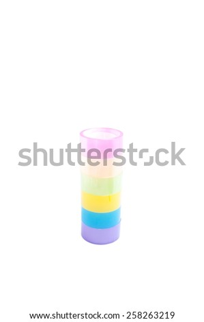 Roll of colorful cellophane tape. Isolated on white background. - stock photo