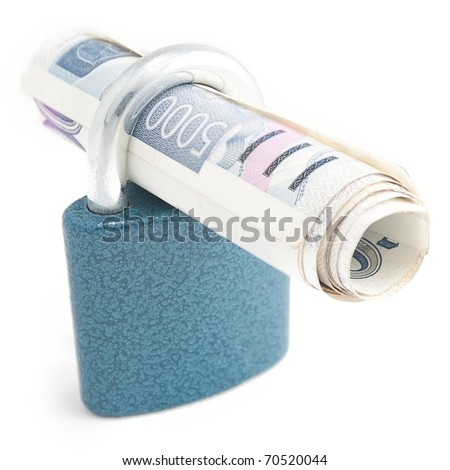 Roll of czech banknotes protected by padlock. - stock photo