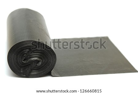 Roll of disposable trash bags isolated over white background - stock photo
