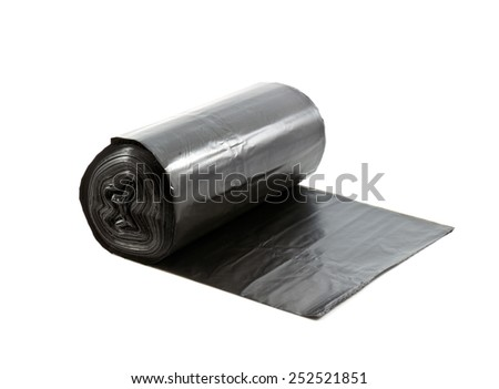 roll of disposable trash bags isolated over white background Stock Photo: - stock photo