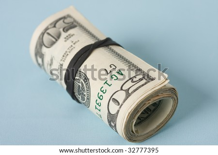 roll of dollars on blue background