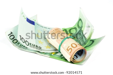 Roll of 50 euro banknotes with a rubber band and one hundred euro banknotes - stock photo