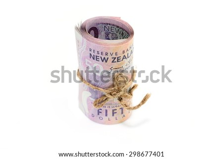Roll of fifty Dollar New Zealand Tied in Burlap String Isolated on a White Background. - stock photo