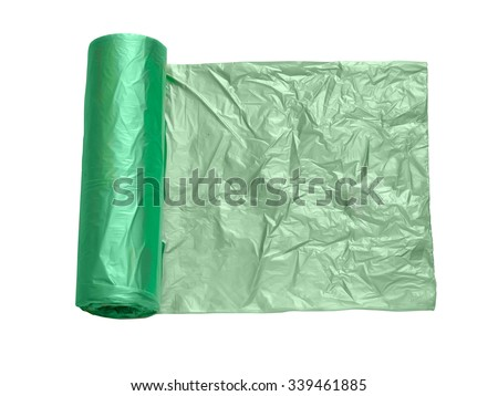 Roll of green plastic garbage bags isolated on white background. Top view. - stock photo