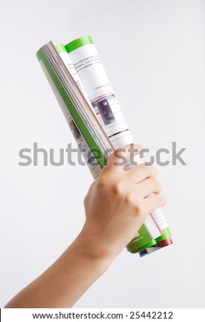 Roll of magazine in hand. Isolated on white - stock photo