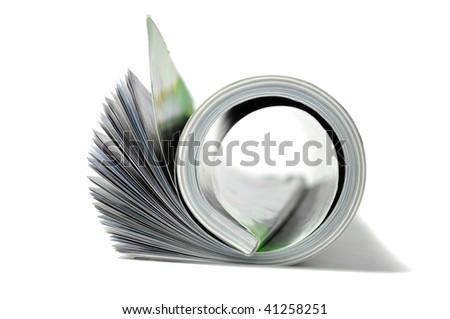 Roll of magazine isolated on white background - stock photo
