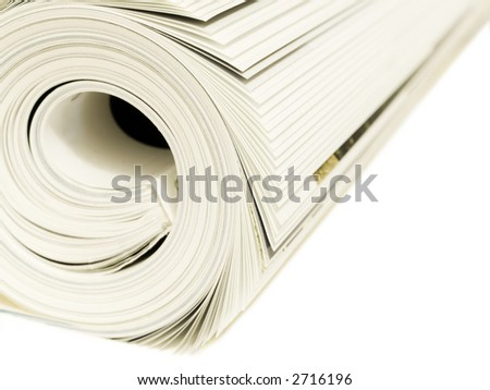 Roll of magazines isolated on a white background. Shallow DOF - stock photo