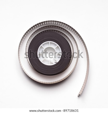 Roll of 35mm film on white background - stock photo
