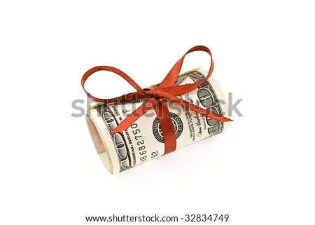 Roll of money and red bow - stock photo