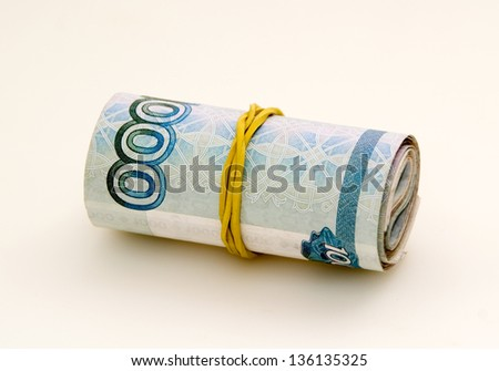 Roll of money fixed with rubber band - stock photo