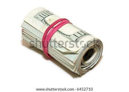 roll of money wrapped with a red elastic laying on side isolated