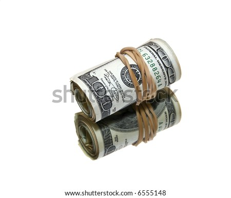 roll of money wrapped with an elastic on a mirror