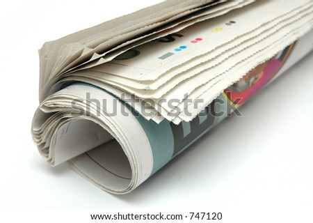 Roll of newspaper on white background