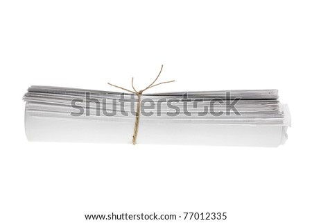 Roll of Newspapers on White Background - stock photo