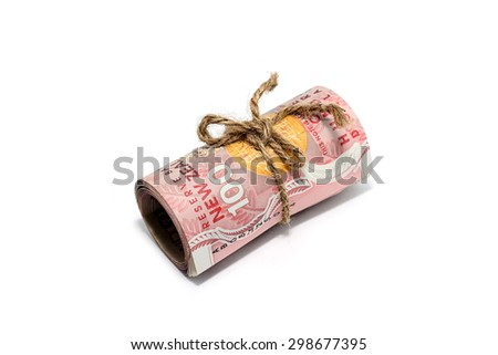 Roll of One Hundred Dollar New Zealand Tied in Burlap String Isolated on a White Background. - stock photo