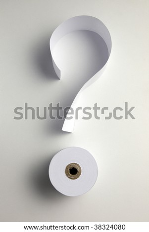 roll of paper and a strip of paper form a question mark - stock photo