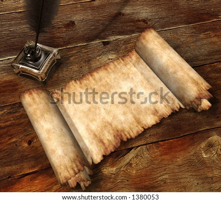 Roll of parchment ink pot and writing quill on old wooden table