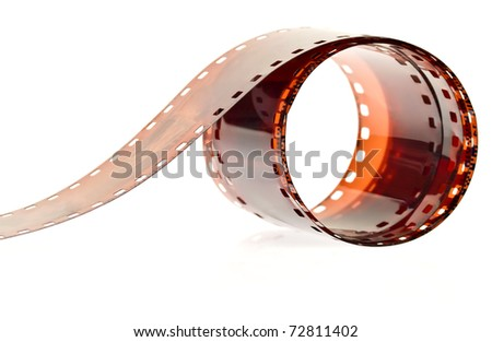 Roll of photography film on a white background - stock photo