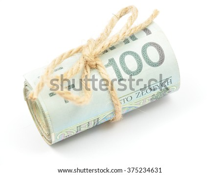 Roll of Polish 100 zloty (PLN) banknotes tied with a burlap string isolated on white background. - stock photo