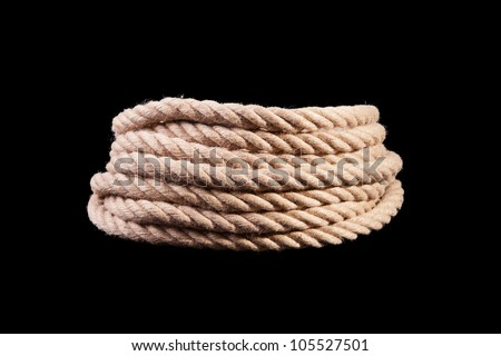 roll of rope isolated on black - stock photo