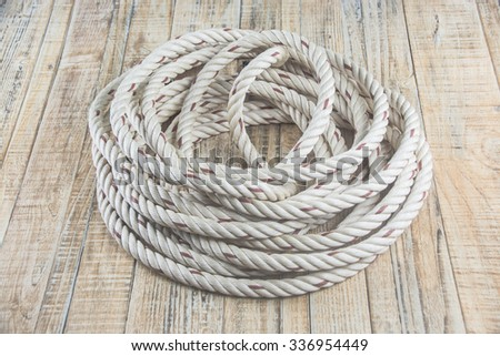 roll of rope isolated on blue - stock photo