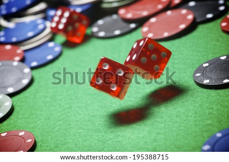 roll of the dice on a game table in a casino - stock photo