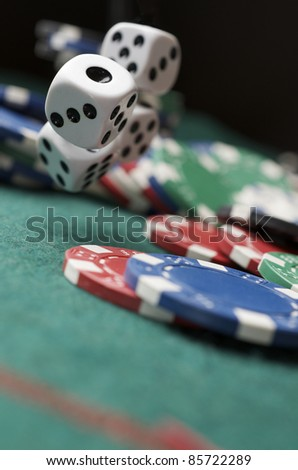 roll of the dice on a game table in a casino