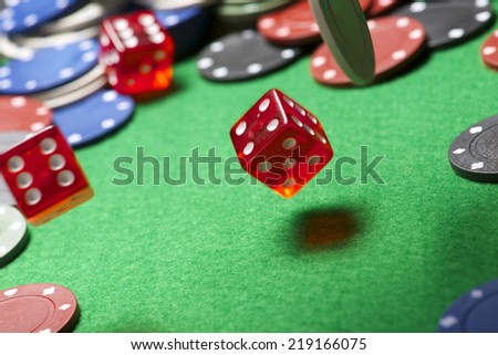 roll of the dice on a game table in a casino, motion blur - stock photo