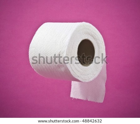 roll of toilet paper on a pink background
