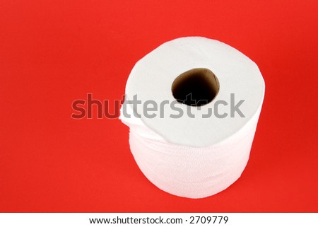 Roll of toilet paper on red